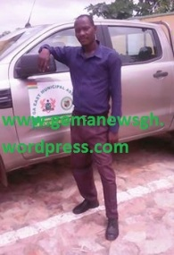 Driver Emmanuel Etse poses with his new vehicle